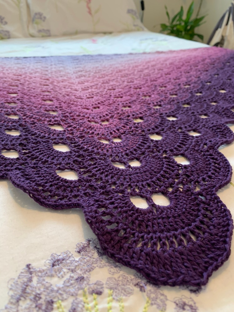 Crocheted Virus Shawl in shades of purple close up